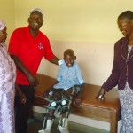 "Riphath and Pauline share a young boys happiness with his new ""calipers"", or leg braces."