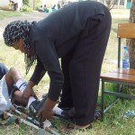 "A young student at Joyland School in Kisumu, Kenya, is getting her braces, or as they call them in Kenya, her ""calipers"", adjusted so they fit her properly."